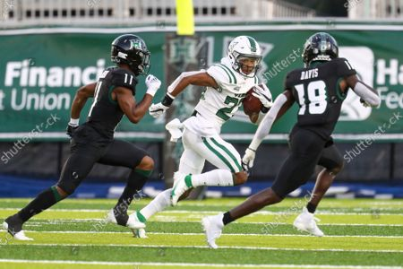 Portland State defensive back Day Day Bright (23) return a kickoff as he is pursued by Hawaii running back Jordan Johnson (11) and Hawaii defensive back Cortez Davis (18) during the first half of an NCAA college football game, in Honolulu