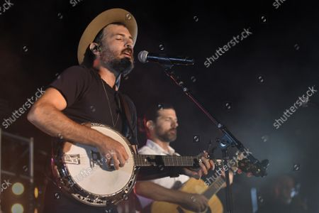The Avett Brothers, a folk-rock band featuring Scott Avett, left, and Seth Avett, perform in a concert after the baseball game between the Baltimore Orioles and the New York Yankees, in Baltimore