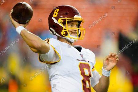 Stock Picture of Washington Football Team quarterback Kyle Allen (8) throws the ball before the start of an NFL football game against the New York Giants, in Landover, Md