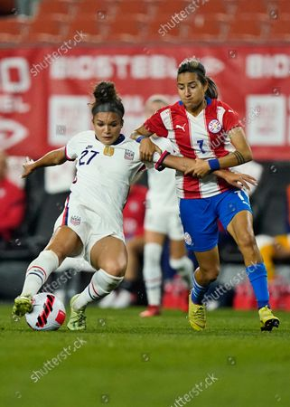 United States forward Sophia Smith (27) and Paraguay midfielder Celsa Sandoval (7) battle for the ball during the second half of an international friendly soccer match, in Cleveland