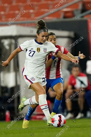 Forward Sophia Smith (27) and Paraguay midfielder Celsa Sandoval (7) battle for the ball during the second half of an international friendly soccer match, in Cleveland