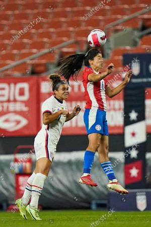 Paraguay midfielder Fany Gauto (6) uses her head against U.S. forward Sophia Smith (27) during the second half of an international friendly soccer match, in Cleveland
