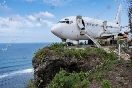 Workers assemble a retired passenger jet, planned to become a tourist attraction, Bali