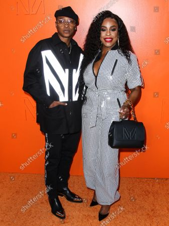 Singer Jessica Betts and wife/actress Niecy Nash arrive at the MARCELL VON BERLIN Spring/Summer 2021 Runway Fashion Show held at the Sheats-Goldstein Residence on September 16, 2021 in Beverly Hills, Los Angeles, California, United States.