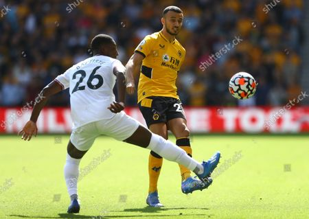 Romain Saiss of Wolverhampton Wanderers and Shandon Baptiste of Brentford in action