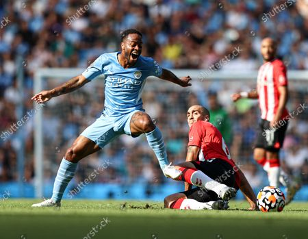 Raheem Sterling of Manchester City is tackled by Oriol Romeu of Southampton