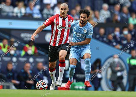 Oriol Romeu of Southampton  and Ilkay Gundogan of Manchester City
