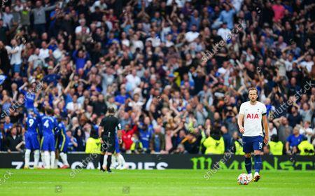 Harry Kane of Tottenham Hotspur reacts as Chelsea celebrates the third goal scored by Antonio Rudiger