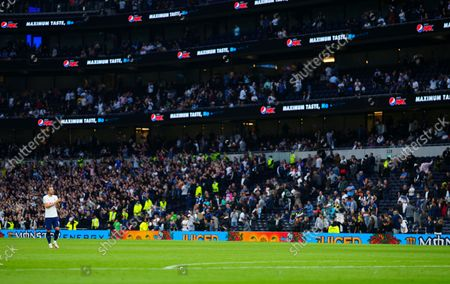 Harry Kane of Tottenham Hotspur applauds the fans at full time
