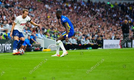 Harry Kane of Tottenham Hotspur takes on Antonio Rudiger of Chelsea on the right wing