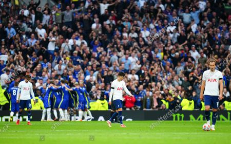 Stock Image of Dele Alli, Son Heung-Min and Harry Kane of Tottenham Hotspur react as Chelsea celebrate their third goal