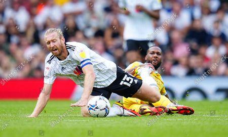 Junior Hoilett of Reading fouls Tim Ream of Fulham