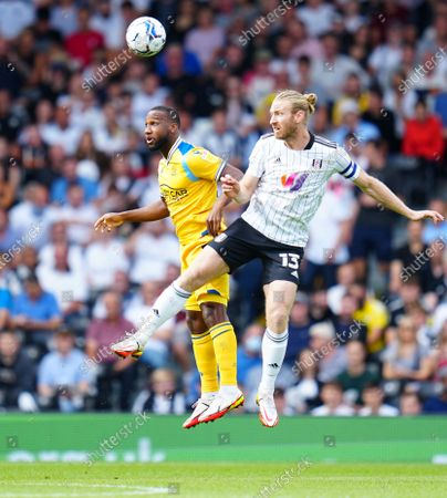 Junior Hoilett of Reading battles with Tim Ream of Fulham