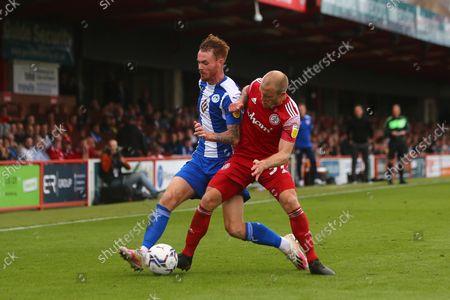 Wigan's Tom Naylor and Accrington's David Morgan