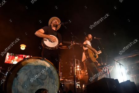 Folk-Rock Band, The Avett Brothers, featuring Scott Avett, left, and Seth Avett perform in a post game concert after the Baltimore Orioles and New York Yankees baseball game, in Baltimore