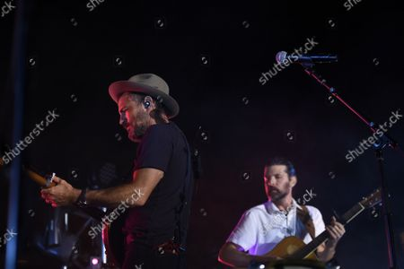 Folk- Rock Band, The Avett Brothers, featuring Scott Avett, left, and Seth Avett perform in a post game concert after the Baltimore Orioles and New York Yankees baseball game, in Baltimore