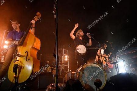 Folk-Rock Band, The Avett Brothers, featuring Scott Avett, center, and Seth Avett, right, perform in a post game concert after the Baltimore Orioles and New York Yankees baseball game, in Baltimore