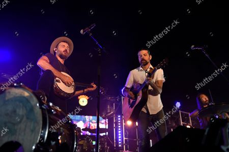 Stock Picture of Folk-Rock Band, The Avett Brothers, featuring Scott Avett, left, and Seth Avett perform in a post game concert after the Baltimore Orioles and New York Yankees baseball game, in Baltimore