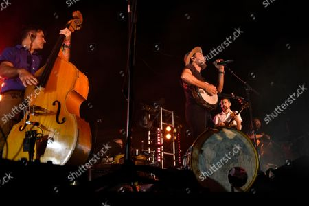 Stock Image of Folk-Rock Band, The Avett Brothers, featuring Scott Avett, center, and Seth Avett, right, perform in a post game concert after the Baltimore Orioles and New York Yankees baseball game, in Baltimore