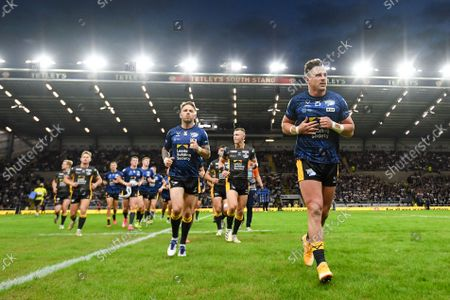 Leeds Rhinos's James Donaldson, Richie Myler and teammates leave the field prior to the match between Leeds Rhinos v Hull KR