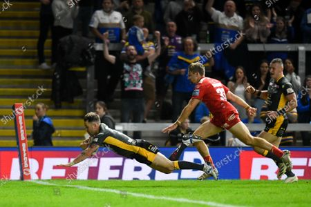 Richie Myler of Leeds Rhinos dives to score his sides fourth try against Hull KR