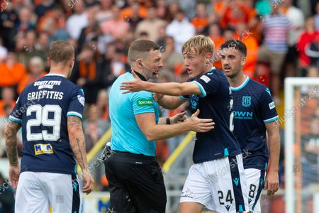 Referee John Beaton holds back Max Anderson of Dundee after a nasty challenge from Calum Butcher of Dundee United; Tannadice Park, Dundee, Scotland: Scottish Premier League football, Dundee United versus Dundee.