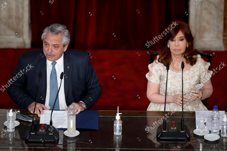 Argentina's President Alberto Fernández, left, delivers his annual State of the Nation address which marks the opening session of Congress, next to Vice President Cristina Fernandez de Kirchner in Buenos Aires, Argentina. Their party was defeated in the legislative primaries held on