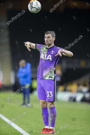 Ben Davies of Tottenham Hotspur throwing the ball in to play from the side line; Molineux Stadium, Wolverhampton, West Midlands, England; EFL Cup football, Wolverhampton Wanderers versus Tottenham Hotspur.