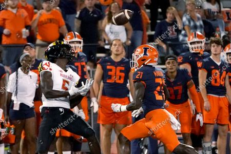 Maryland wide receiver Rakim Jarrett catches a deep pass from quarterback Taulia Tagovailoa as Illinois defensive back Jartavius Martin watches during the first half of an NCAA college football game, in Champaign, Ill