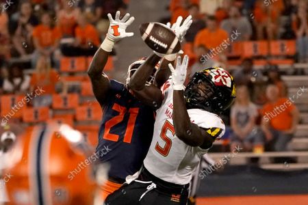 Illinois defensive back Jartavius Martin (21) breaks up a pass intended for Maryland wide receiver Rakim Jarrett during the second half of an NCAA college football game, in Champaign, Ill. Maryland won 20-17