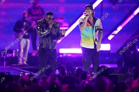 Nelly, left, performs with Tyler Hubbard of Florida Georgia Line on the first night of the 2021 iHeartRadio Music Festival, in Las Vegas