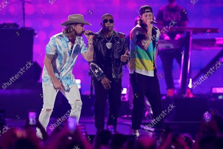 Stock Photo of Nelly, center, performs with Brian Kelley, left, and Tyler Hubbard of Florida Georgia Line on the first night of the 2021 iHeartRadio Music Festival, in Las Vegas