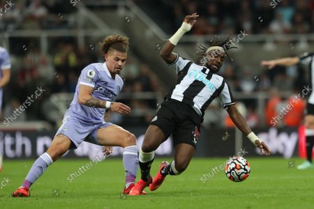 Leeds United's Kalvin Phillips in action with Allan Saint-Maximin  during the Premier League match between Newcastle United and Leeds United at St. James's Park, Newcastle on Friday 17th September 2021.