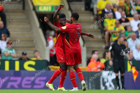Ismaila Sarr (L) is congratulated by Joshua King (R) of Watford after scoring a goal to make it 3-1 - Norwich City v Watford, Premier League, Carrow Road, Norwich, UK - 18th September 2021Editorial Use Only - DataCo restrictions apply