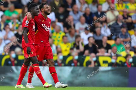 Stock Picture of Ismaila Sarr (L) is congratulated by Joshua King (R) of Watford after scoring a goal to make it 3-1 - Norwich City v Watford, Premier League, Carrow Road, Norwich, UK - 18th September 2021Editorial Use Only - DataCo restrictions apply