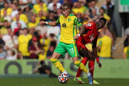Brandon Williams of Norwich City and Ismaila Sarr of Watford - Norwich City v Watford, Premier League, Carrow Road, Norwich, UK - 18th September 2021Editorial Use Only - DataCo restrictions apply