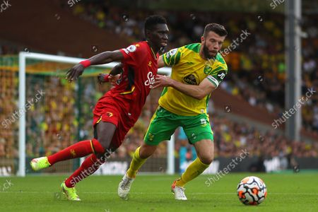 Stock Image of Grant Hanley of Norwich City and Ismaila Sarr of Watford - Norwich City v Watford, Premier League, Carrow Road, Norwich, UK - 18th September 2021Editorial Use Only - DataCo restrictions apply
