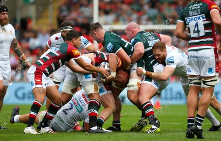 Ben Youngs of Leicester Tigers takes the ball from Hanro Liebenberg of Leicester Tigers