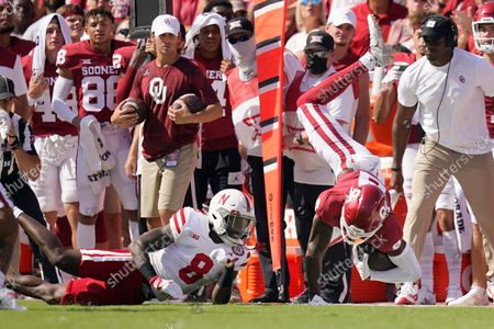 Oklahoma wide receiver Michael Woods II, right, is upended by Nebraska safety Deontai Williams (8) in the first half of an NCAA college football game, in Norman, Okla