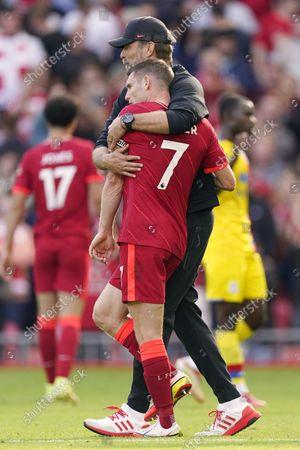 Liverpool Manager, Jurgen Klopp hugging James Milner at the final whistle