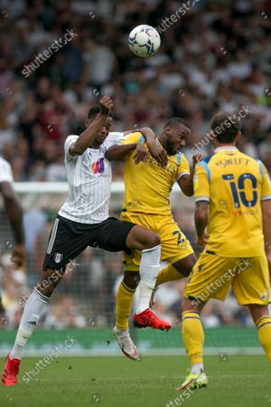 Junior Hoilett of Reading battle for the ball during the Sky Bet Championship match between Fulham and Reading at Craven Cottage, London on Saturday 18th September 2021.