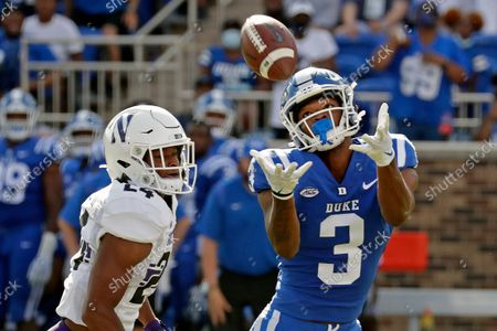 Duke wide receiver Darrell Harding Jr. (3) hauls in a pass for a big gain against Northwestern defensive back Rod Heard II (24) during the first half of an NCAA college football game in Durham, N.C., . Duke scored shortly after this play