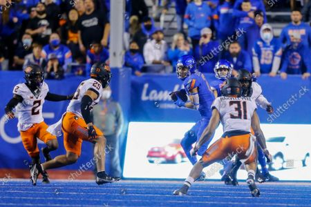 Stock Picture of Boise State wide receiver Khalil Shakir (2) turns after a reception in front of Oklahoma State safety Jason Taylor II (25) and safety Kolby Harvell-Peel (31) during the second half of an NCAA college football game, in Boise, Idaho