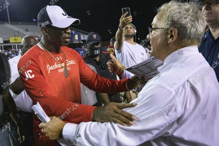 Louisiana Monroe head coach Terry Bowden gives a thumbs up to Jackson State head coach Deion Sanders after Louisiana Monroe snapped its losing streak in a 12-7 victory during an NCAA football game, in Monroe, La