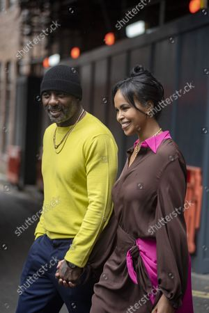Idris Elba with his wife Sabrina exit Roland Mouret fashion screening at The Soho Hotel during London Fashion Week, Spring Summer Collection, 2022.