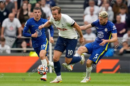 Chelsea's Jorginho, right, tries to stop Tottenham's Harry Kane during the English Premier League soccer match between Tottenham Hotspur and Chelsea at the Tottenham Hotspur Stadium in London, England