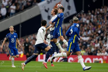 Tottenham's Harry Kane, center left, jumps for the ball with Chelsea's Andreas Chistensen, center right, during the English Premier League soccer match between Tottenham Hotspur and Chelsea at the Tottenham Hotspur Stadium in London, England