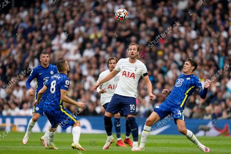 Tottenham's Harry Kane, center, eyes the ball with Chelsea's Mateo Kovacic, left, and Andreas Chistensen, right, during the English Premier League soccer match between Tottenham Hotspur and Chelsea at the Tottenham Hotspur Stadium in London, England