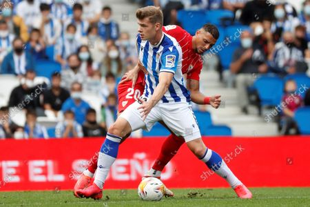 Stock Picture of Real Sociedad's striker Alexander Sorloth (front) vies for the ball with Sevilla's defender Diego Carlos Santos (back) during the Spanish LaLiga soccer match between Real Sociedad and Sevilla FC held at eale Arena stadium in San Sebastian, northern Spain, 19 September 2021.