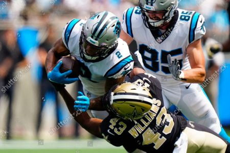 Carolina Panthers wide receiver D.J. Moore is tackled by New Orleans Saints free safety Marcus Williams during the first half of an NFL football game, in Charlotte, N.C